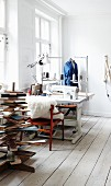 Industrial sewing machine in sewing studio with stylised Christmas tree made from reclaimed wooden boards