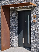Modern entrance to house with corten steel porch
