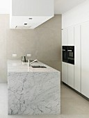 Marble island counter in bright modern kitchen