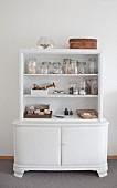 Flotsam in preserving jars decorating old dresser