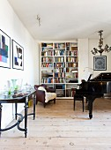 Antiques, grand piano and bookcase in living room