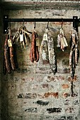 Various types of sausages hanging from butchers' hooks, South Africa