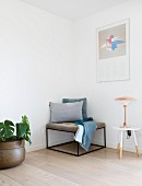 Upholstered stool with delicate metal frame in corner