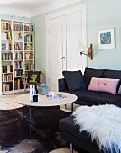 Black couch, white double doors and bookcase in living area