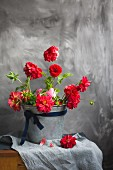 Red dahlias in zinc bucket