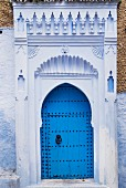 Ornate portal with traditional blue door in Morocco