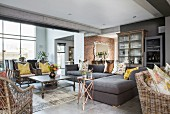 Sofa set and wicker furniture in lounge with concrete ceiling beams
