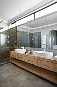 Long washstand and transom windows in modern bathroom
