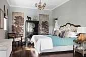 Painted wall panels and black Oriental cabinet in classic bedroom