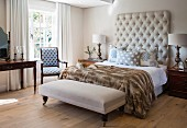 Classic bedroom with bedroom bench and button-tufted headboard