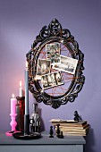 Black picture frame decorated with spider-web arrangement for Halloween