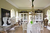 Long dining table and collection of busts in grand dining room