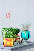 Plant pots with colourful felt covers as ornaments or as gifts