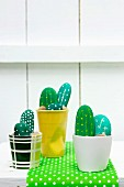 Small cacti garden made from painted pebbles