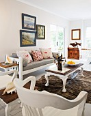White wooden furniture and cowhide rug in living room