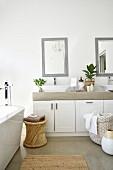 Twin washstand in modern bathroom in shades of grey