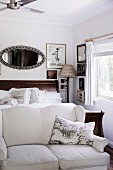 Vintage style bedroom with sofa in front of bed and picture wall