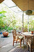Seat with rattan furniture on the terrace in the jungle