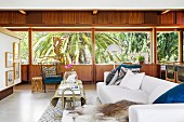Lounge with wood paneling and palm tree views
