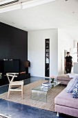Modern living room with a clear design and black wall