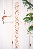 Garland of dried apple slices on shabby-chic door