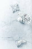 Silver Christmas decorations on marble surface