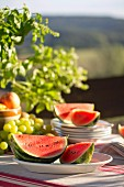 Watermelon on table set for summer picnic