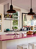 Pink kitchen worktop on kitchen counter in open kitchen with retro flair