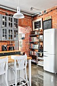 Brick walls and bookcase in industrial-style kitchen