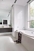 Modern white bathroom with black vanity unit