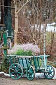 Purple gypsophila in zinc bucket in vintage pull-along cart