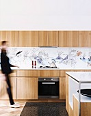 Modern kitchen with wooden fronts and artistic splash protection