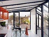 Rooftop conservatory with access to roof terrace