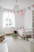 Bunting in child's bedroom in white and pink