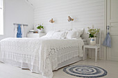 Rustic bedroom in decorated white and blue