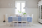 Blue-striped tablecloth on table in rustic dining room