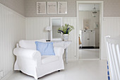 White armchair against wainscoting