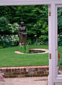 Pond with bronze figure as a water feature