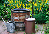 Wooden barrel with curved water inlet as fountain