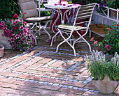 Terrace paving made of granite mosaic and bricks