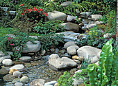 Creek with small granite pier and pebbles