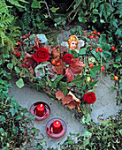 Grave decorations, heart on wire mesh heart filled with leaves