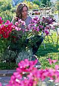 Young woman cutting bouquet