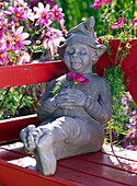 Figure 'Dozy' on red bench
