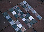 Mosaic of different colored small paving stones