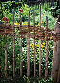 Wooden wicker fence for the cottage garden