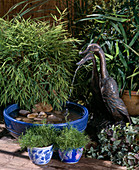Running ducks as Gargoyles, blue bowl with gravel, Pogonatherum