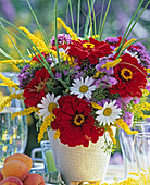 Bouquet with zinnias, daisies, Solidago (Goldenrod), Ageratum