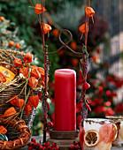 Candlestick with Calluna vulgaris, Physalis (Lampionblume)