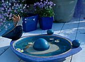 Birdbath, blue pots
